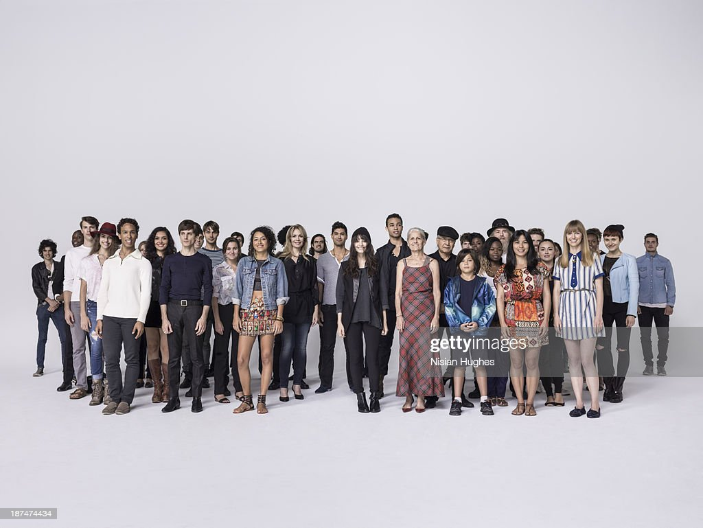 Large Group of people standing together in studio : Stock Photo