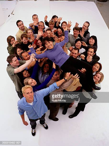 Large group of people standing together, posing in studio, portrait, elevated view