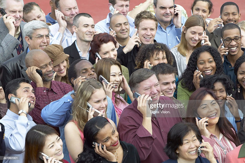 Large Group of People Talking on Mobile Phones : Stock Photo