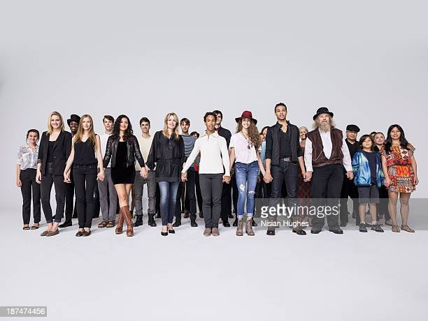 large group of people together holding hands - large group of people imagens e fotografias de stock