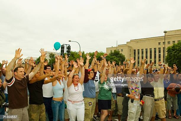 large group of people waving their arms at a gay parade - parade stock pictures, royalty-free photos & images