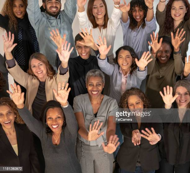 a large group of people with their hands up - black history month stock pictures, royalty-free photos & images