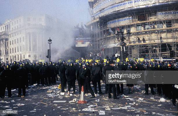 A large group of police officers in Trafalgar Square London during the Poll Tax riot 31st March 1990