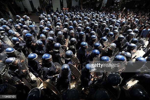 A large group of policemen moves towards students at a protest during which clashes erupted between security forces and students demanding political...