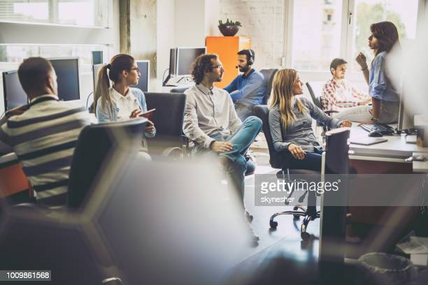 large group of programmers having a staff meeting in the office. - call center stock pictures, royalty-free photos & images