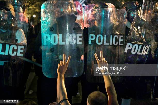 A large group of protestors lingered late at the perimeter of Lafayette Square to protest racism and President Trump in Washington DC in the early...