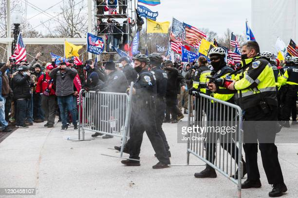 Large group of pro-Trump protesters face off against police with pepper spray after protesters storm the grounds of the Capitol Building on January...