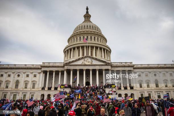 Large group of pro-Trump protesters stand on the East steps of the Capitol Building after storming its grounds on January 6, 2021 in Washington, DC....