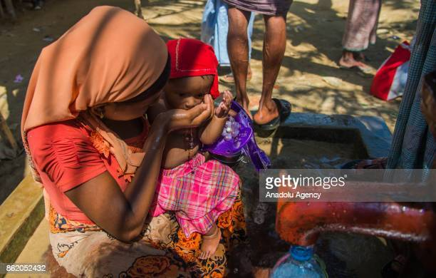 COX'S BAZAR BANGLADESH OCTOBER 16 A large group of Rohingya people fled from ongoing military operations in Myanmars Rakhine state try to cross the...