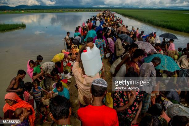 COX'S BAZAR BANGLADESH OCTOBER 17 A large group of Rohingya people fled from ongoing military operations in Myanmars Rakhine state try to cross the...