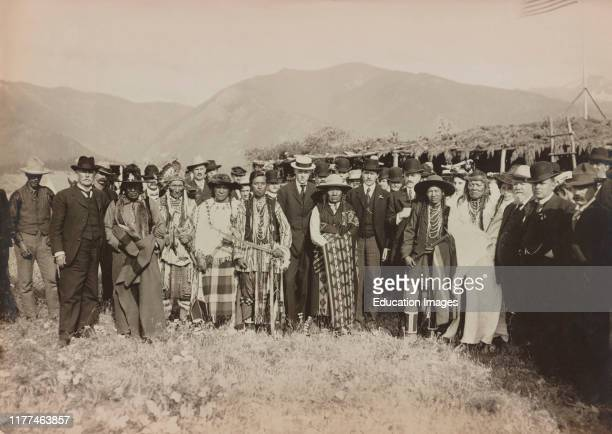 Large Group of Salish American Indians gathered with Secretary of the Interior, James Rudolph Garfield, Flathead Indian Reservation, Montana, USA,...