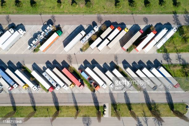 large group of semi trucks at truck stop - food distribution stock pictures, royalty-free photos & images