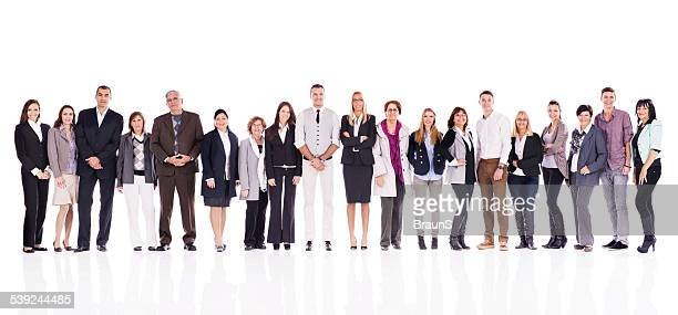 Large group of smiling business people in a line.