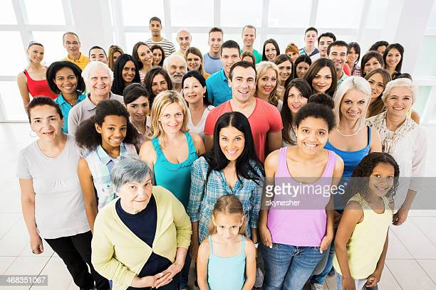Large group of smiling people.