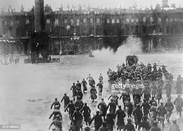 A large group of Soviet soldiers reenacts the storming of the Winter Palace in Petrograd three years to the day after it happened