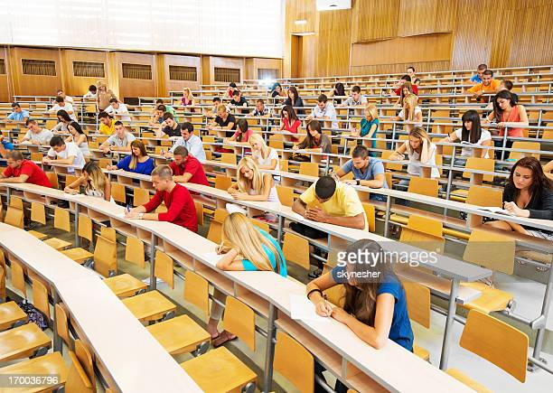 Large group of students doing exam.