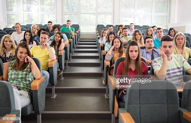 Large group of students sitting in lecture hall.