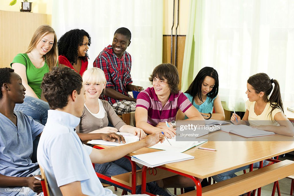 Large group of students studying together in the classroom. : Stock Photo