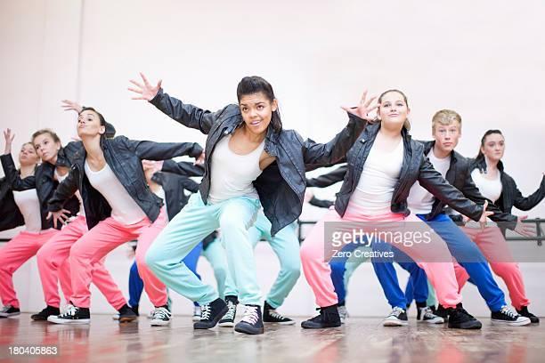 Large group of teenagers dancing in studio