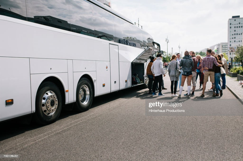 Large group of Tourist waiting to get on Bus : Stock Photo