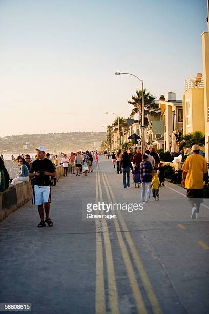 Large group of tourists walking on a pier, San Diego, California, USA