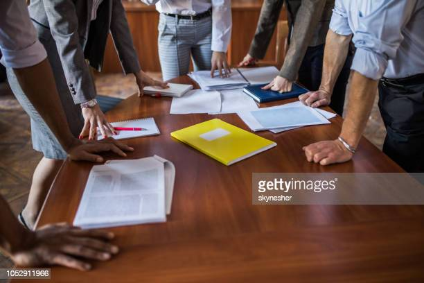 large group of unrecognizable business people having a meeting in the office. - executive director stock pictures, royalty-free photos & images