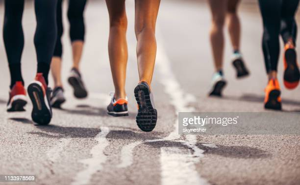 Large group of unrecognizable marathon runners having a race on the road.