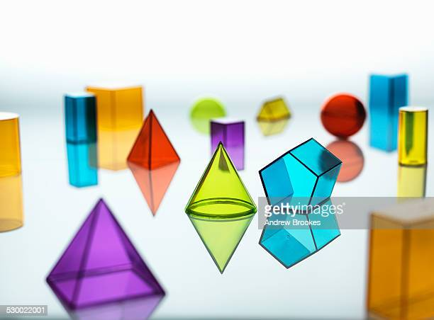 large group of various multi colored geometric shapes - cone shaped objects stock pictures, royalty-free photos & images