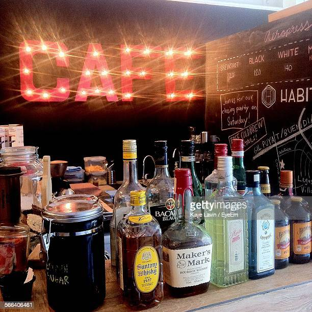 Large Group Of Whisky Bottle Variations On Counter In Cafe