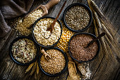 Large group of wholegrain food shot on rustic wooden table