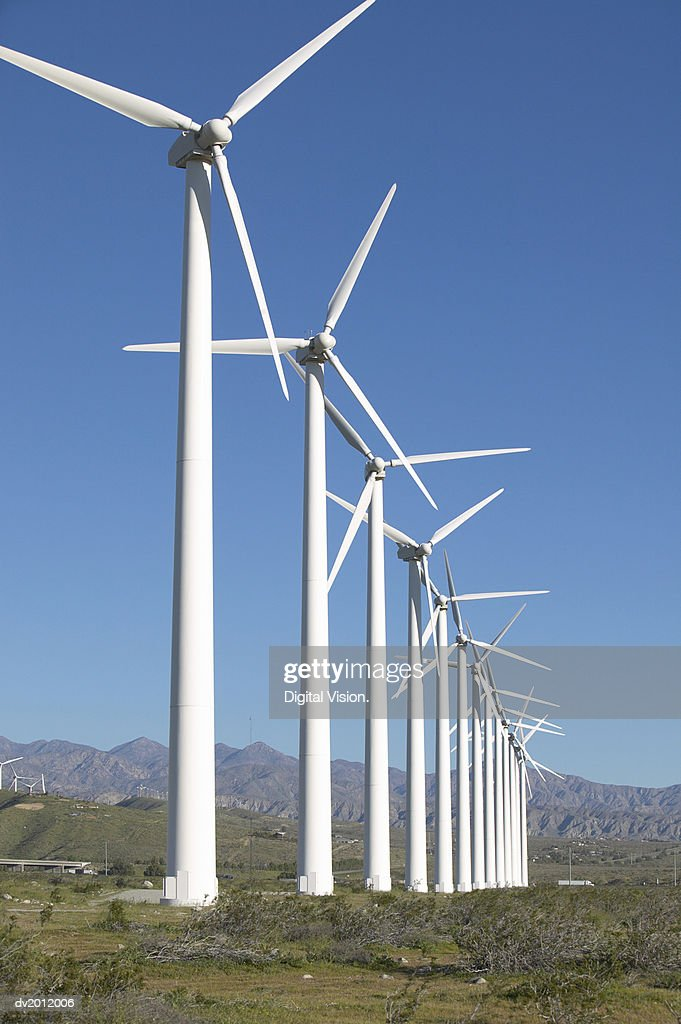 Large Group of Wind Turbines in a Row at a Wind Farm : Stock Photo