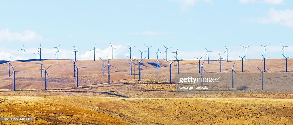 Large group of wind turbines on hills : Foto stock