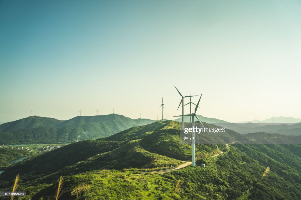 large group of wind turbines on the mountain near by sea : Stockfoto