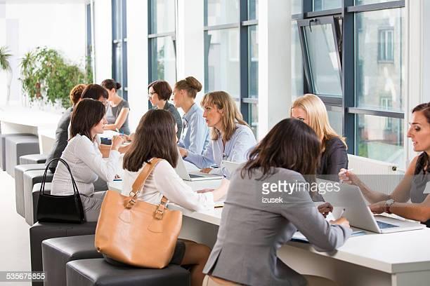 large group of women at job fair - job fair stock pictures, royalty-free photos & images