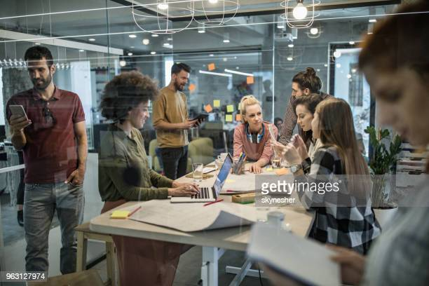large group of young entrepreneurs working different things in the office. - staff meeting stock pictures, royalty-free photos & images