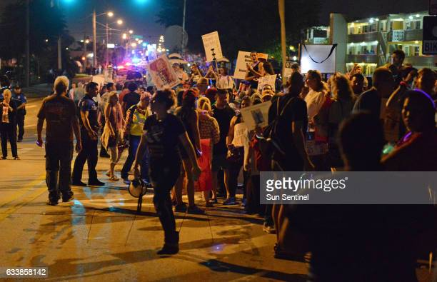 A large group protesting President Trump organized in front of Trump Plaza in West Palm Beach Fla to begin their march toward MaraLago Trump's...
