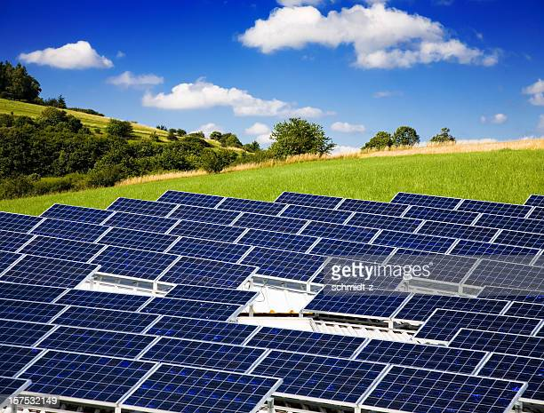 large grouping of solar panels in a rural setting - solar energy dish stock pictures, royalty-free photos & images