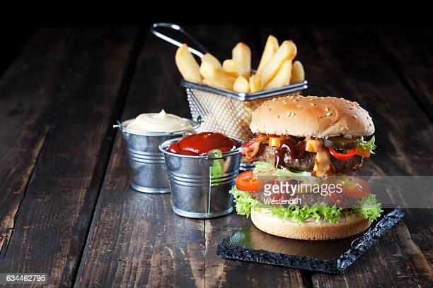 Large hamburger with fries, mayonnaise and ketchup