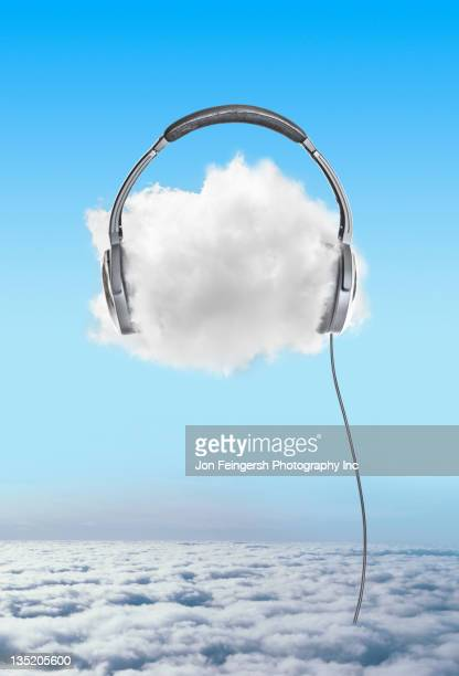 large headphones on cloud in sky - audio equipment stock pictures, royalty-free photos & images