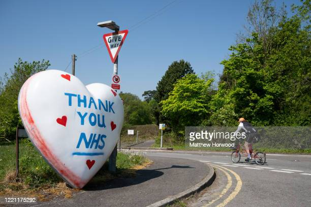 A large heart with the words 'Thank you NHS' propped up against a street sign in recognition of the NHS and other key workers on April 26 in Cardiff...
