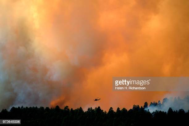 A large helicopter looks for a spot to make a water drop on the 416 fire on June 12 2018 in Hermosa Colorado The fire burning 23 miles northwest of...
