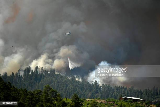 A large helicopter makes a water drop on the 416 fire on June 12 2018 in Hermosa Colorado The fire burning 23 miles northwest of Durango started June...