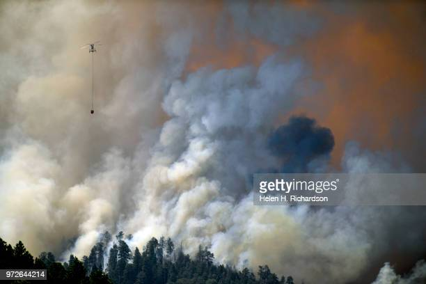 A large helicopter returns for water after making a water drop on the 416 fire on June 12 2018 in Hermosa Colorado The fire burning 23 miles...