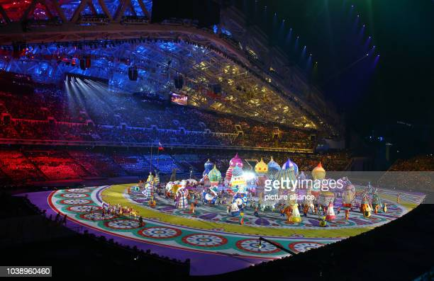 Large helium inflatables create the elements of St. Basil's during the Opening Ceremony in Fisht Olympic Stadium at the Sochi 2014 Olympic Games,...