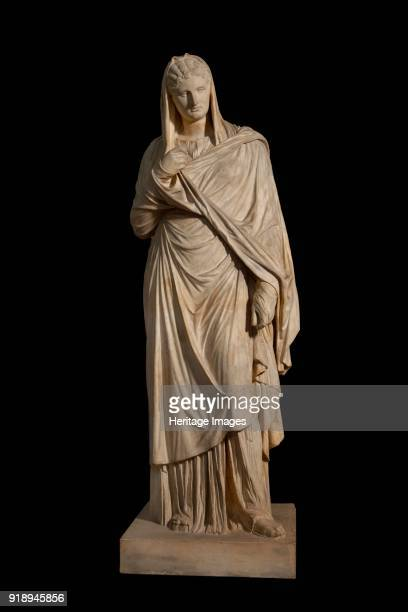 Large Herculaneum woman 1st century Statue of woman or goddess wearing sandals a long chiton and a himation pulled up over the back of the head Copy...