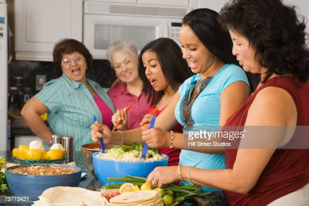large hispanic family in kitchen preparing food - niece stock pictures, royalty-free photos & images