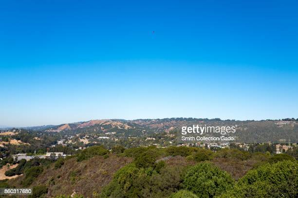 Large homes are visible along the Oakland Hills near Chabot Regional Park in the East Bay region of the San Francisco Bay Area, Oakland, California,...