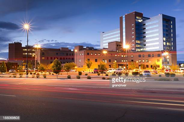 large hospital at dusk - medical building stock pictures, royalty-free photos & images