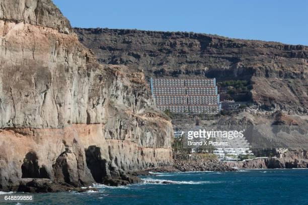 Large hotels under the cliffs at Puerto de Mogan