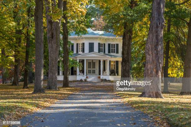 Large House (Mansion) Among Trees in Autumn Colors in Rhinebeck, Hudson Valley, New York.